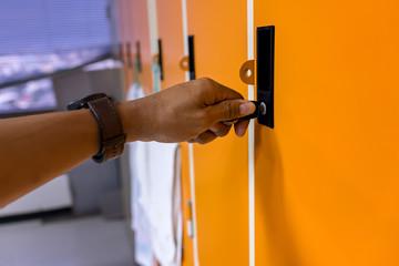 Opening locker with key.