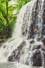 small waterfall  in public garden