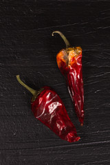 Two hot red dry peppers