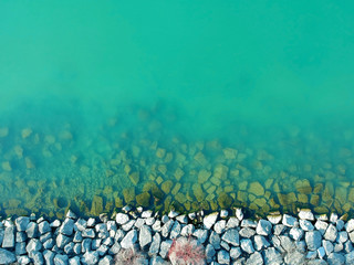 Aerial view of sea calm water and fantastic rock coast. Hot summer concept.