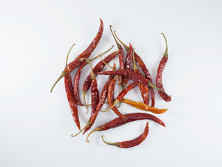 Dried red chili on white background.