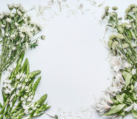 Wall Mural - Beautiful floral frame layout with green flowers for bouquet making on white background, top view