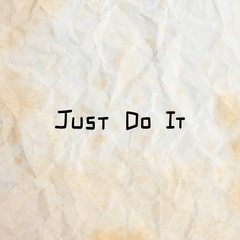 Just do it quote on old crumpled paper