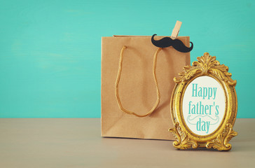 Image of shopping bag, present for dad. Father's day concept