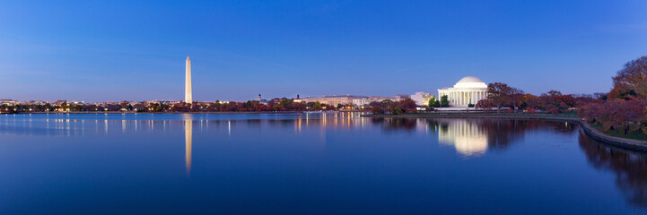 Jeffeerson Memorial and Washington Monument reflected on Tidal Basin in the evening, Washington DC, USA. Panoramic image