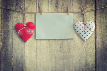 Heart and paper hanging on wood Background and Texture, Vintage toned.