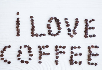 I Love Coffee phrase spelled out of roasted coffee beans isolated on white background