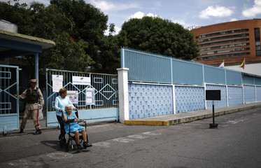 Voters depart a polling during the presidential election in Caracas