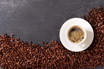cup of coffee and coffee beans, top view