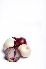 Food concept on white background, group of white and red onions close up copy space isolated