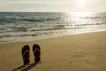 Flip flop at the seaside - Stock Image