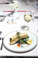 River fish with chard and potatoes served in the restaurant