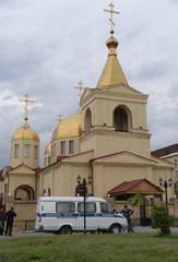 Law enforcement officers gather outside an Orthodox church after the attack of militants in Grozny