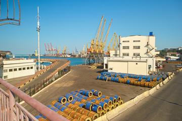 Barrels on sea port stock. Pile of cargo barrels, cargo for transportation.