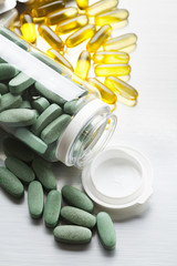 Green and yellow medicines on a gray steel table