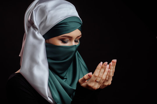 close up side view shot of Islamic woman with closed eyes has converted to Islam. Muslim beahaviour. Islam traditions. ask forgiveness for sins and errors