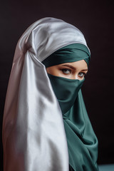 close up portrait of Moslem female in stylish hijab. islamic cultural traditions