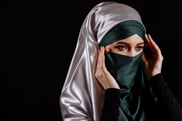 close up portrait of Arab female checking her headscarf