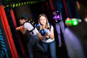 Girl playing laser tag
