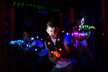 Emotional guy playing laser tag