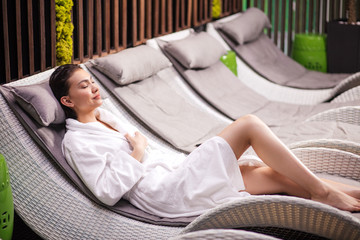 young good-looking woman spending time in the modern European spa center