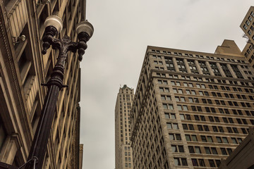 Looking up at classic skyscrapers
