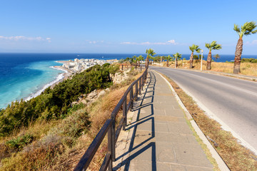 Coastal promenade and road with view of beautiful Rhodes bay. Greece