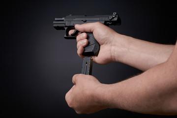 reloading a handgun, inserting ammunition clip