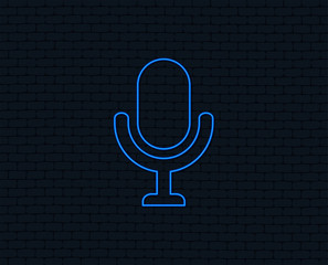 Neon light. Microphone icon. Speaker symbol. Live music sign. Glowing graphic design. Brick wall. Vector
