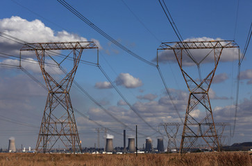 Electricity pylons are seen near cooling towers of South African petrochemical company Sasol's synthetic fuel plant in Secunda, north of Johannesburg