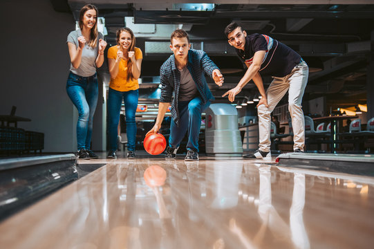 Friends having fun while bowling, happy hour