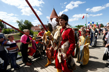 People walk at the parade during the Hansa Days, a medieval festival, in Kaunas