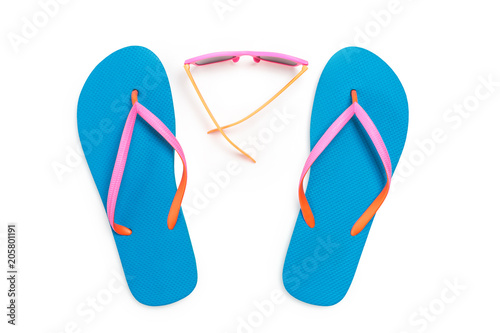 52de9719aee0 Blue Flip Flops and Pink Sunglasses Isolated on White Background. Top view