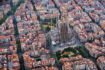 Barcelona Eixample residencial district, Sagrada familia, typical urban squares, Spain. Aerial view