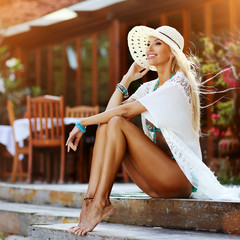 Beautiful woman in hat outdoor portrait