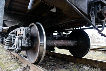 Railway transport: Iron wheels of the freight car on rails.