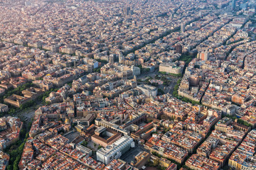 Barcelona aerial view of Placa de Catalunya with typical urban grid, Spain. Late afternoon light
