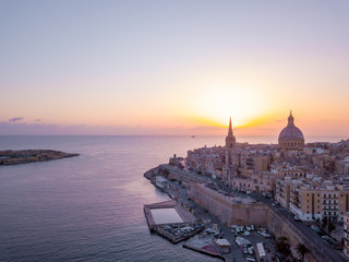 Beautiful aerial sunset view of the Valletta city in Malta. Beautiful city from above with amazing old architecture.