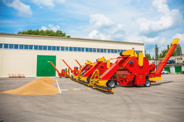 Agriculture modern farm vehicle. Grain loader combine, thrower and separator of wheat harvesters, Industrial automation machines