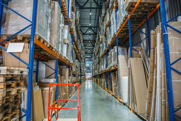 Logistics equipment, Large hangar warehouse with lots shelves or racks with pallets of goods. Industrial shipping and cargo delivery distribution