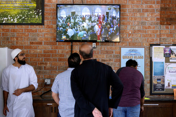 Members of the community watch a funeral prayer service for Sabika Sheikh at the Brand Lane Islamic Center in Stafford