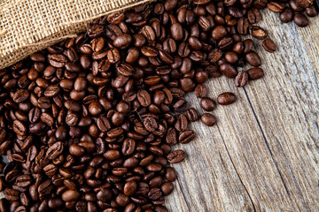 Dark roasted coffee beans with a hessian or jute natural colour sacking