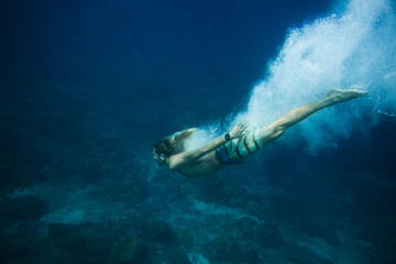 underwater pic of young man diving in ocean alone Wall mural