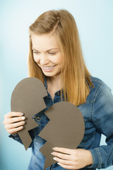 Happy young woman with broken heart
