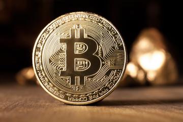 bitcoin token on wooden surface