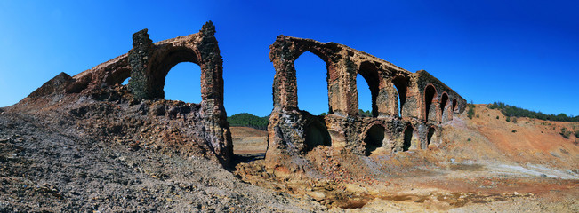 Ruins of a very old aqueduct in the so-called route of the mills, a great place for hiking in the province of Huelva, Spain