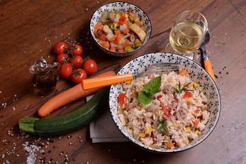 Bowl with rice salad and seasoning