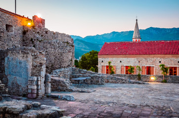 Fortress yard in old district of Budva at sunset, Montenegro