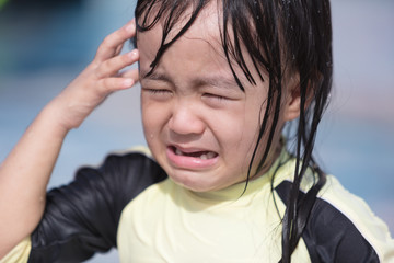 Asian Little Chinese Girl crying in Swimming Pool