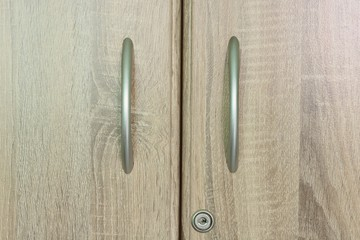 Brown wooden wardrobe drawer with one keyhole